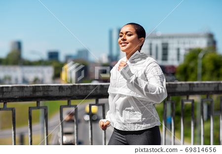 african american woman running outdoors 69814656