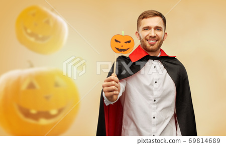 happy man in halloween costume of vampire 69814689