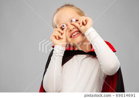 girl in halloween costume of dracula with eyeballs 69814691