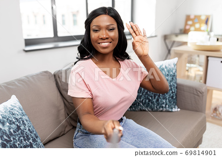 happy african american woman taking selfie at home 69814901