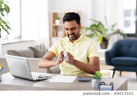 angry man with laptop working at home office 69815032