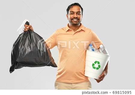 smiling indian man sorting paper and plastic waste 69815095