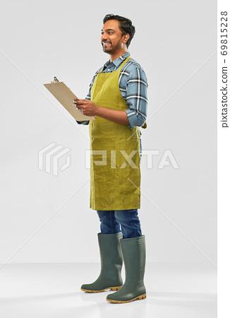 happy indian gardener or farmer with clipboard 69815228