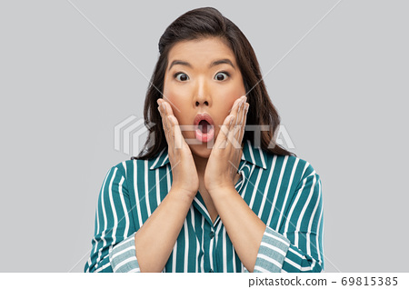 shocked asian woman over grey background 69815385