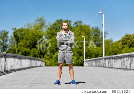portrait of young man outdoors 69815626