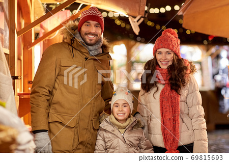 happy family at christmas market in city 69815693