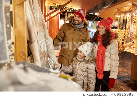 happy family at christmas market in city 69815995
