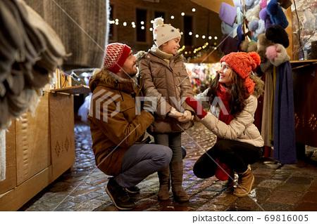 happy family at christmas market in city 69816005