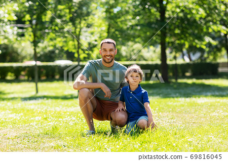 happy smiling father and little son at summer park 69816045