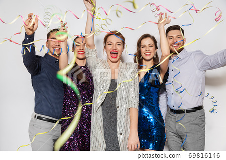 friends throwing party streamers and having fun 69816146
