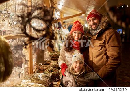 happy family at christmas market in city 69816259