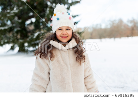 happy little girl in winter clothes outdoors 69816298