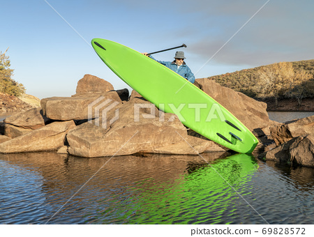 launching inflatable stand up paddleboard 69828572