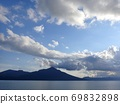 Calm Lake Shikotsu, blue sky, white clouds 69832898
