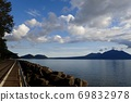 Blue sky and white clouds while driving along the shore of Lake Shikotsu 69832978