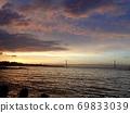 Akashi Kaikyo Bridge in the sunrise sky and the Seto Inland Sea 69833039