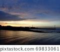 The sea illuminated by the sunrise and the Akashi Kaikyo Bridge 69833061