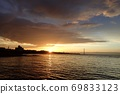 The sky after the rain illuminated by the oranges of the morning sun and the Seto Inland Sea 69833123
