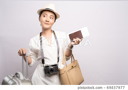 Tourist woman with suitcase isolated on white background 69837977