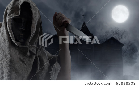 Hooded man with big knife . 69838508