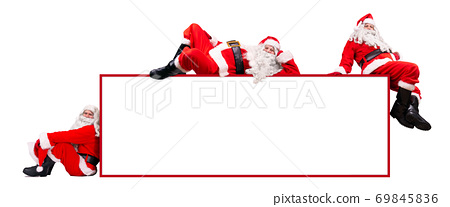 Team of Santa Claus with the empty billboard, isolated on a white background.  69845836