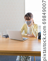 A young woman doing telework [Physical condition] 69849007