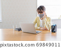 A young woman doing telework [Physical condition] 69849011