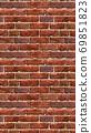 Vertical brown red brick wallpaper. Seamless pattern material 69851823