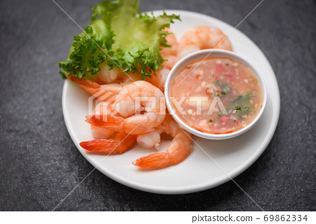 Shrimp delicious seasoning spices on white plate appetizing cooked boiled shrimps prawns , salad shelfish seafood sauce / 69862334