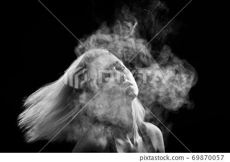 woman in smoke 69870057