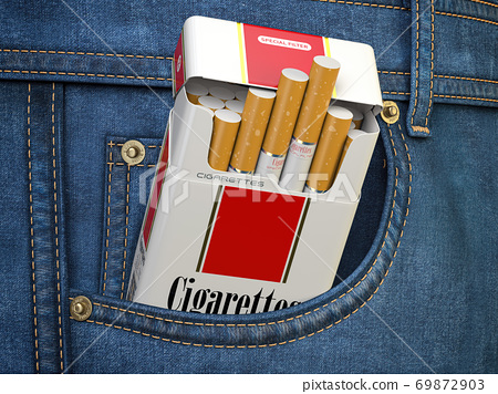 Open packet of cigarettes in jeans pocket. 69872903