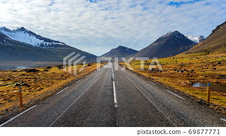 Car driving on beautiful road in Iceland. 69877771
