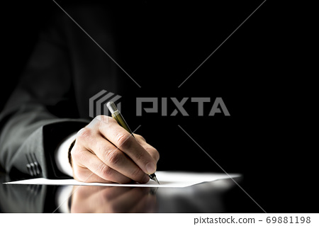 Businessman signing a document 69881198