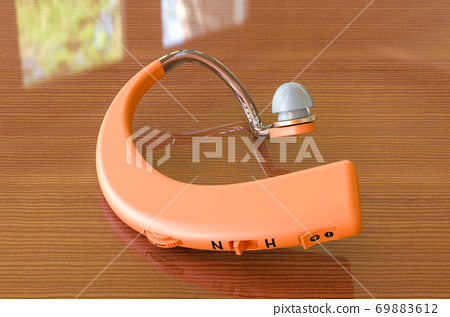 Hearing aid closeup on the wooden table, 3D rendering 69883612