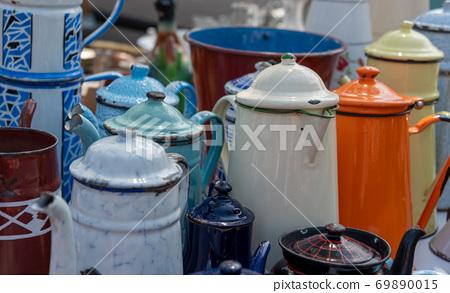 Water jugs on flea market Provence France 69890015