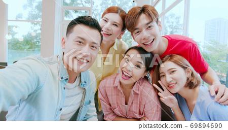 friends take selfie happily 69894690