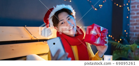 man celebrating xmas online 69895261