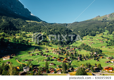 Panoramic view of Grindelwald village. mountain and wooden houses in Switzerland 69895969