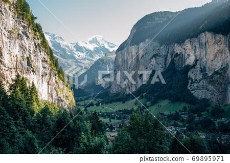 Lauterbrunnen old village with mountains cliff in Switzerland 69895971
