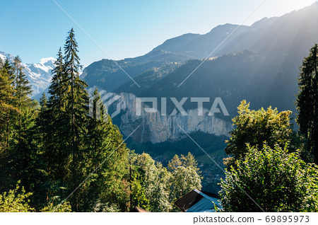 Mountain with green forest in Lauterbrunnen, Switzerland 69895973