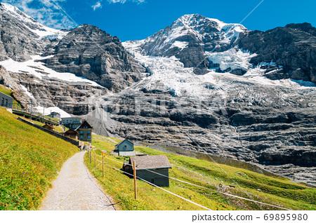 Snowy mountain and hiking trail road at Jungfrau Eigergletscher in Switzerland 69895980