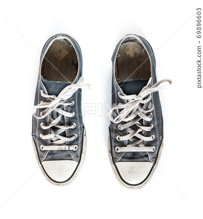Old blue sneakers isolated on white background 69896603