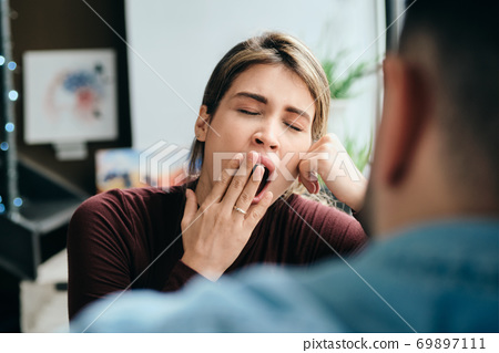 Woman Yawning During Boring Conversation With Partner 69897111