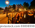 Amterdam canal, bridge and medieval houses in the evening 69898998