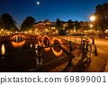 Amterdam canal, bridge and medieval houses in the evening 69899001