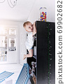 boy climbs  for candy. 69902682
