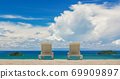 Couple of beach beds on tropical beach with beautyful blue sky 69909897