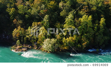 Beautiful weight on a steep mountain slope. Downstream is the Niagara River. Nature of the USA and Canada. 69914069