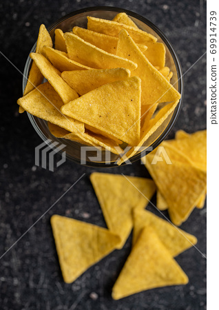 Salted tortilla chips. 69914739