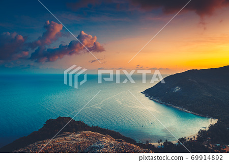 Asia silhouette sunset aerial: ocean bay water at mountain forest, beach of Koh Tao Island, Thailand 69914892
